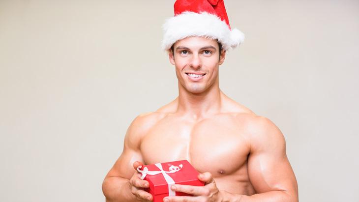 Muscular guy in a Santa costume