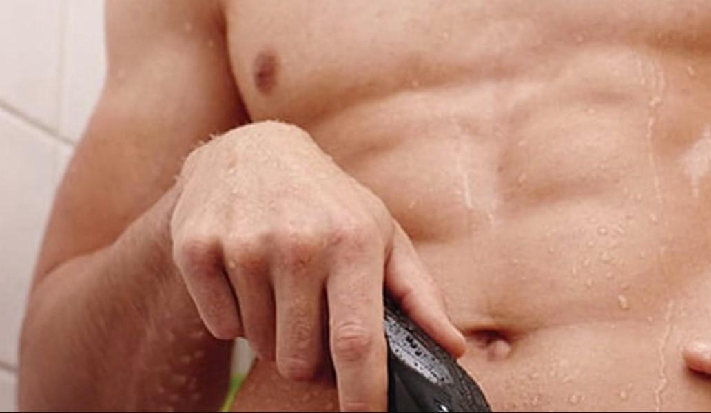 man shaving pubic area
